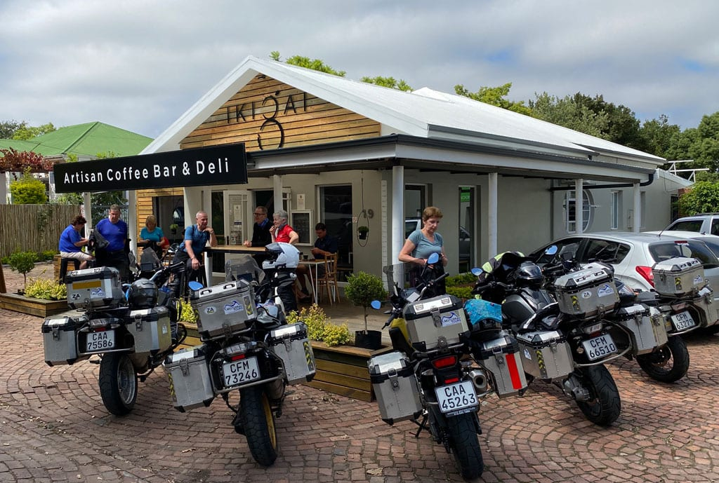 The group stop at an Artisan Coffee Bar with their bikes parked up outside.