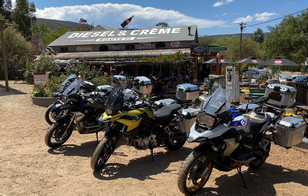 The group's bikes parked up in a row outside a biker café.