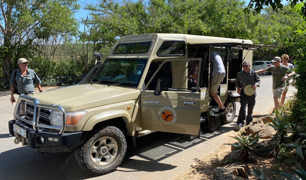 The group get ready to climb into their safari jeep.