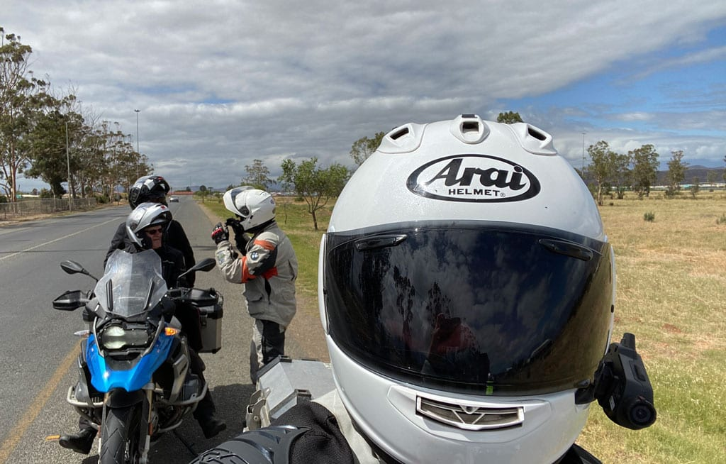 One of the group takes a selfie with their bike helmet on.