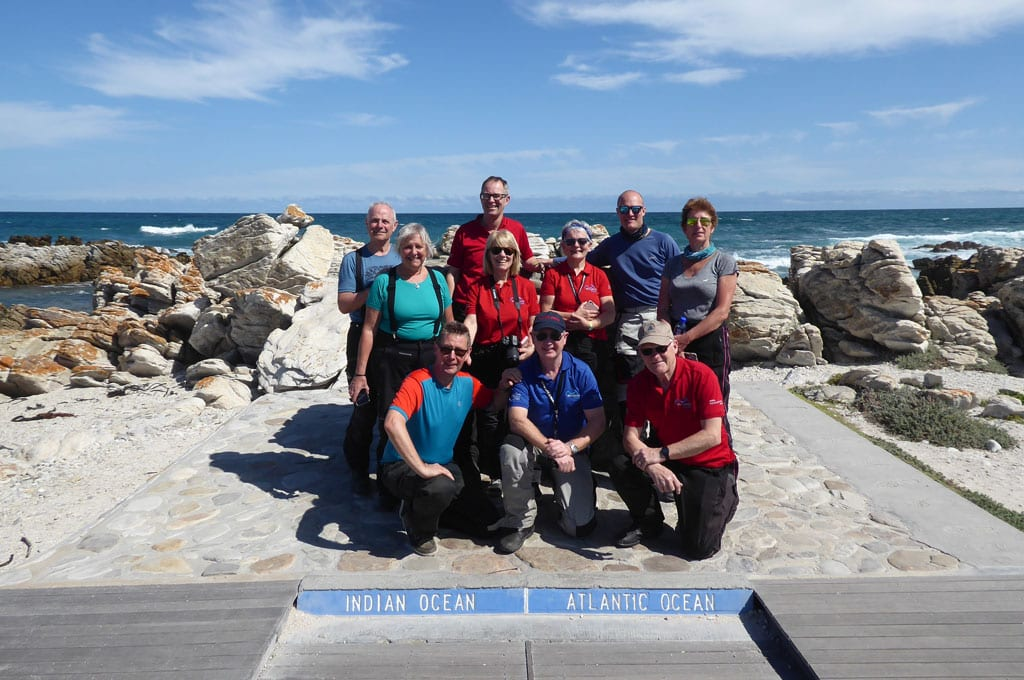 The group pose for a picture on the Indian and Atlantic ocean boarder.